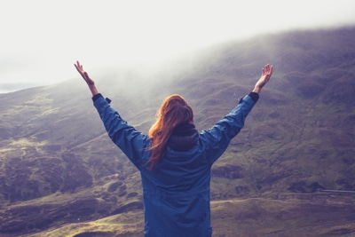Woman expressing freedom on mountain