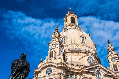view of the Frauenkirche in Dresden and the monument of Martin Luther